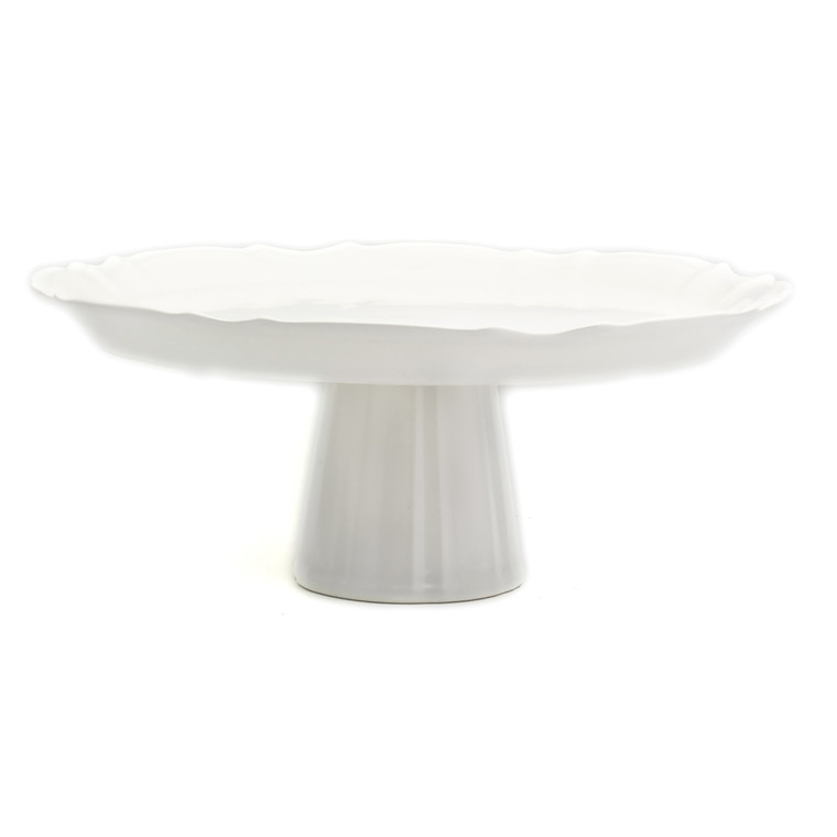 a white cake plate with ruffles