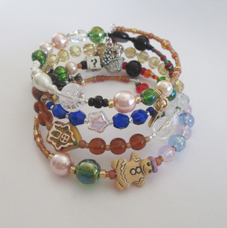 View of the bracelet highlighting the gingerbread house and woman beads.
