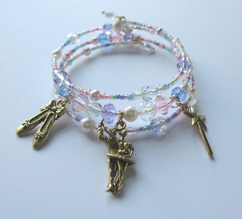 Charms on the Sugar Plum Fairy Bracelet are: the Fairy and her cavalier, ballet shoes and the fairy's magic wand. Inspired by Act 2 of the holiday ballet, The Nutcracker.