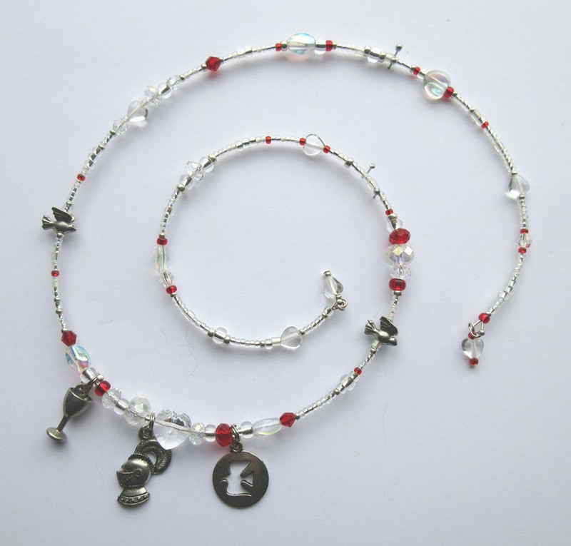 Clear beads symbolize Parsifal's innocence.