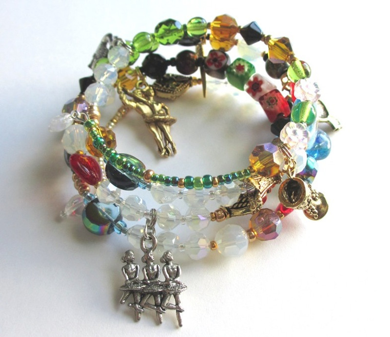 Every bead and charm of the Swan Lake Bracelet indicates a character or moment from the ballet by Tchaikovsky.