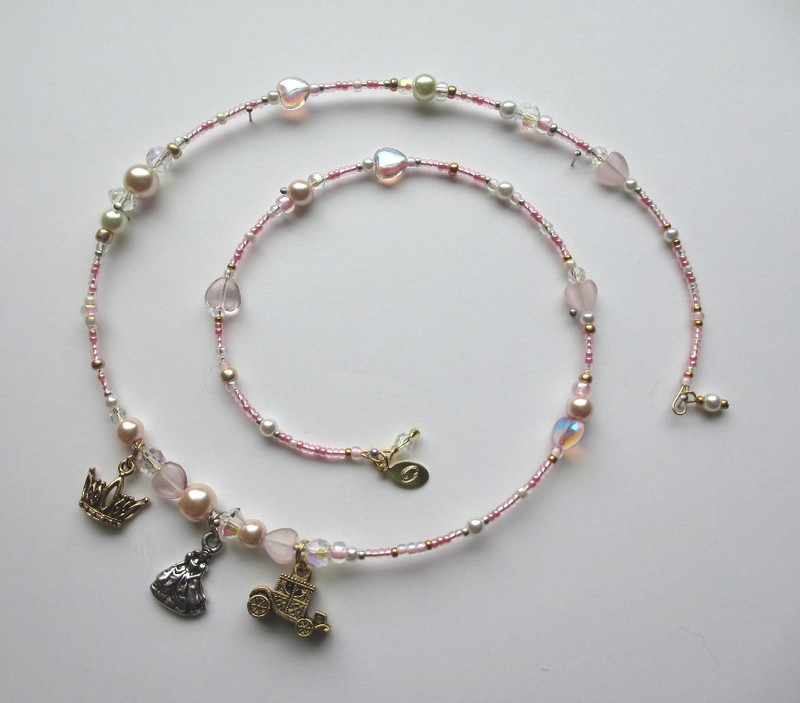 Glass heart beads symbolize Cinderella's good heart and the love of the Prince.