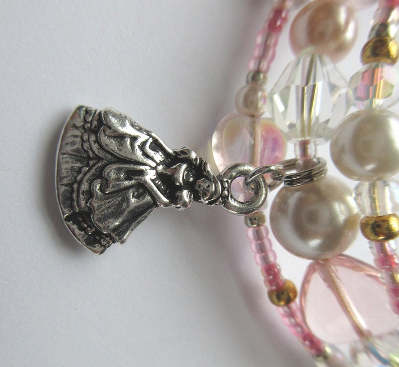 A charm represents Cinderella at the ball.