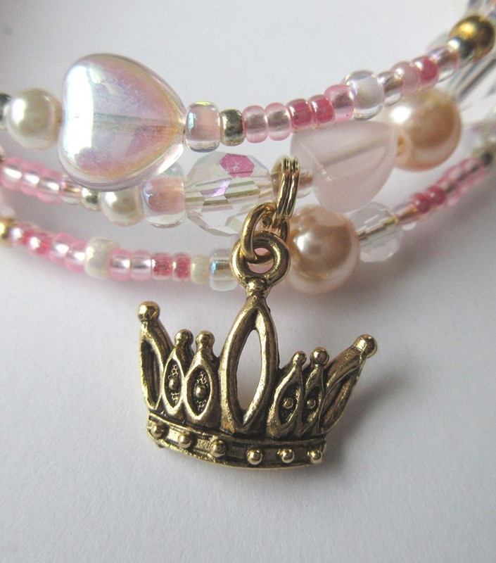 The crown charm symbolizes Cinderella's destiny.