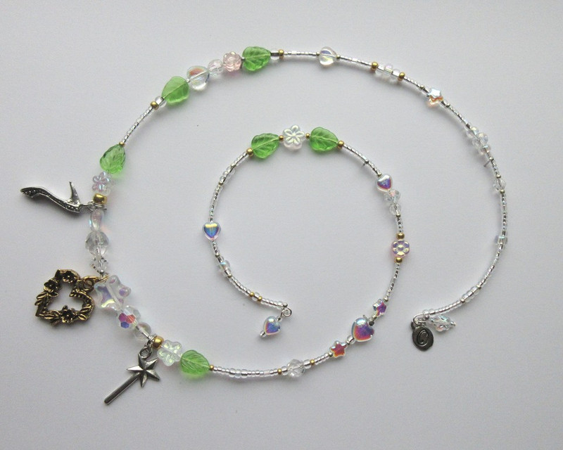 Hearts and stars represent love and magic, while  glass flowers and leaves symbolize the Fairy Godmother's magic arbor.