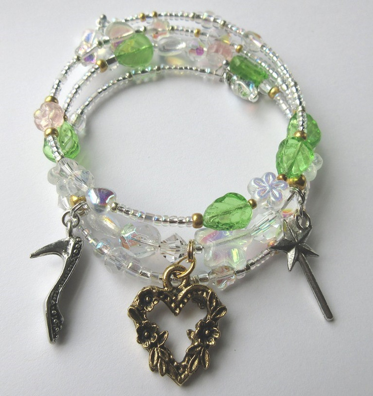 Charms symbolize the fairy's role in Cinderella's journey