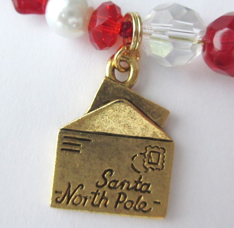The reverse side of the letter to Santa charm.