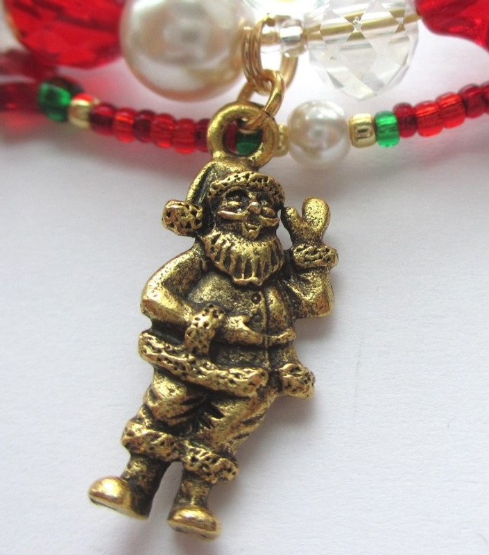 A Santa charm represents Kris Kringle.