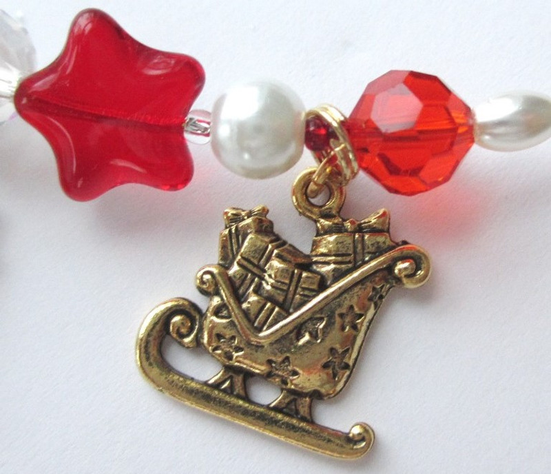 The sleigh charm represents Santa's majestic yearly arrival on Christmas Eve