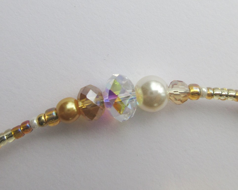 Golden beads evoke the heavenly realm where the angels observe the life and troubles of George Bailey.