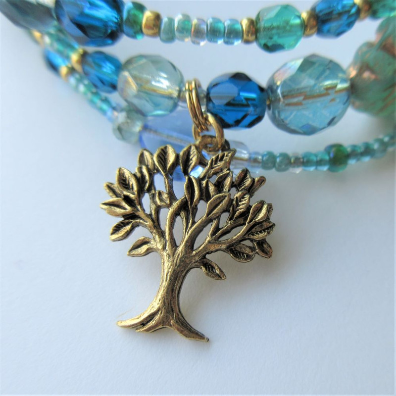 The tree charm is the Linden where Werther asks Charlotte to bury him.