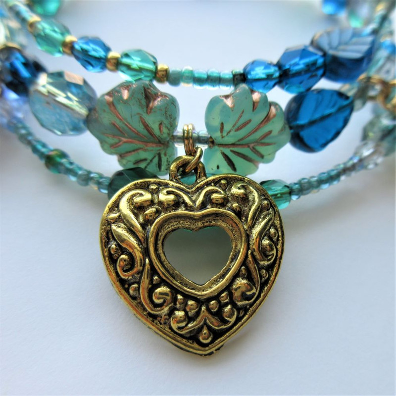 The heart charm with a negative space in its design is Werther's heart filled with pain and loss.