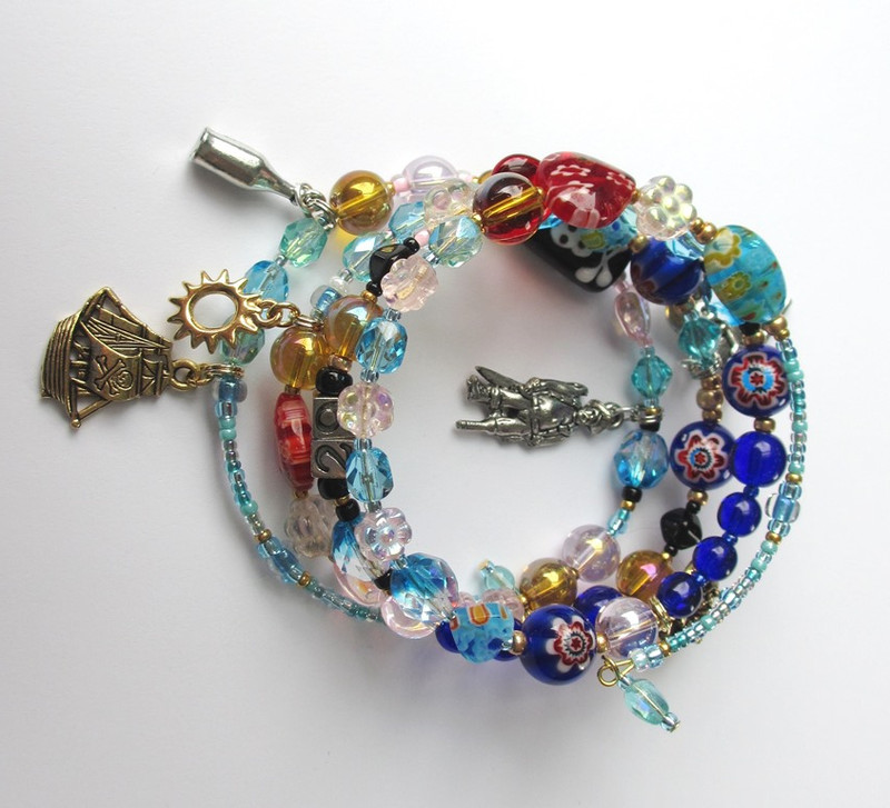 View of the bracelet featuring the Pirate King charm (center)