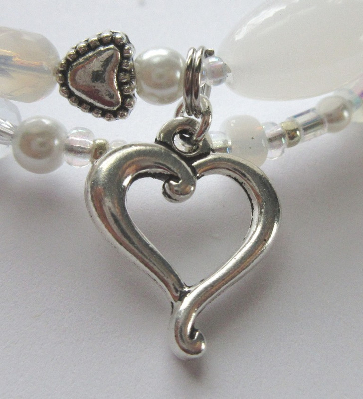 A wavy heart symbolizes Rusalka embracing her prince in the form of a wave.