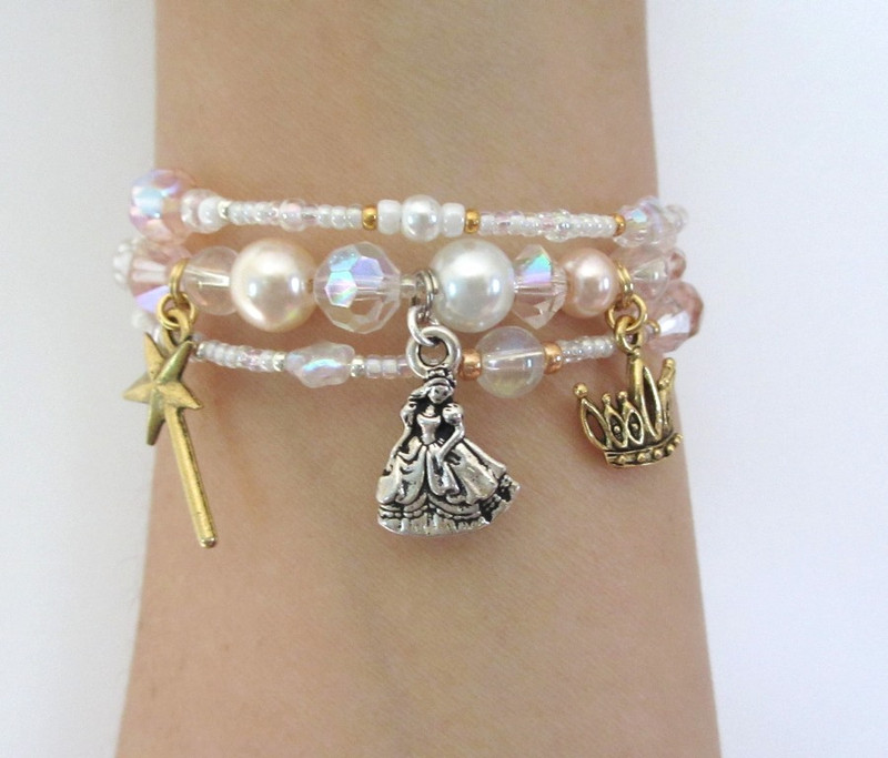 Charms on the Good Witch Bracelet symbolize Glinda's magic wand, her crown and the wise woman herself.