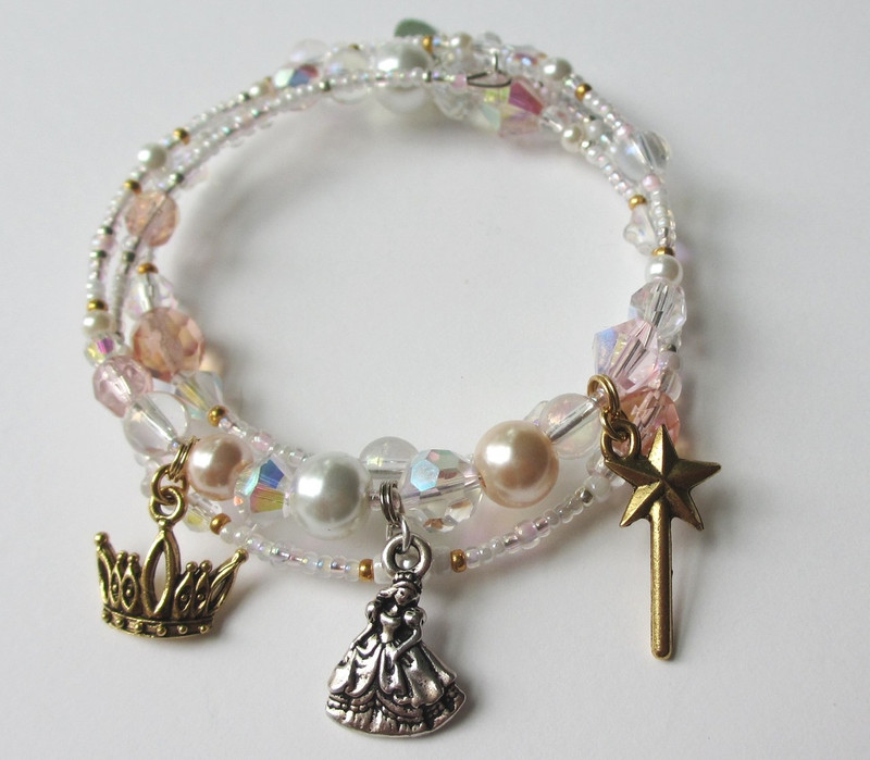The Good Witch bracelet evokes Glinda the Good Witch from the L. Frank Baum novel the Wonderful Wizard of Oz.