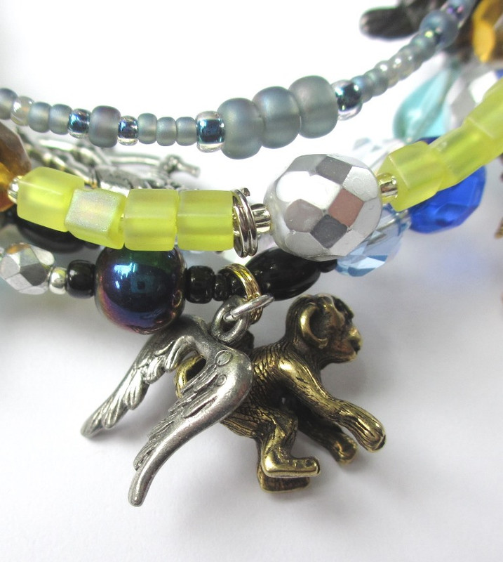 Two charms hang together to represent the iconic Winged Monkeys.