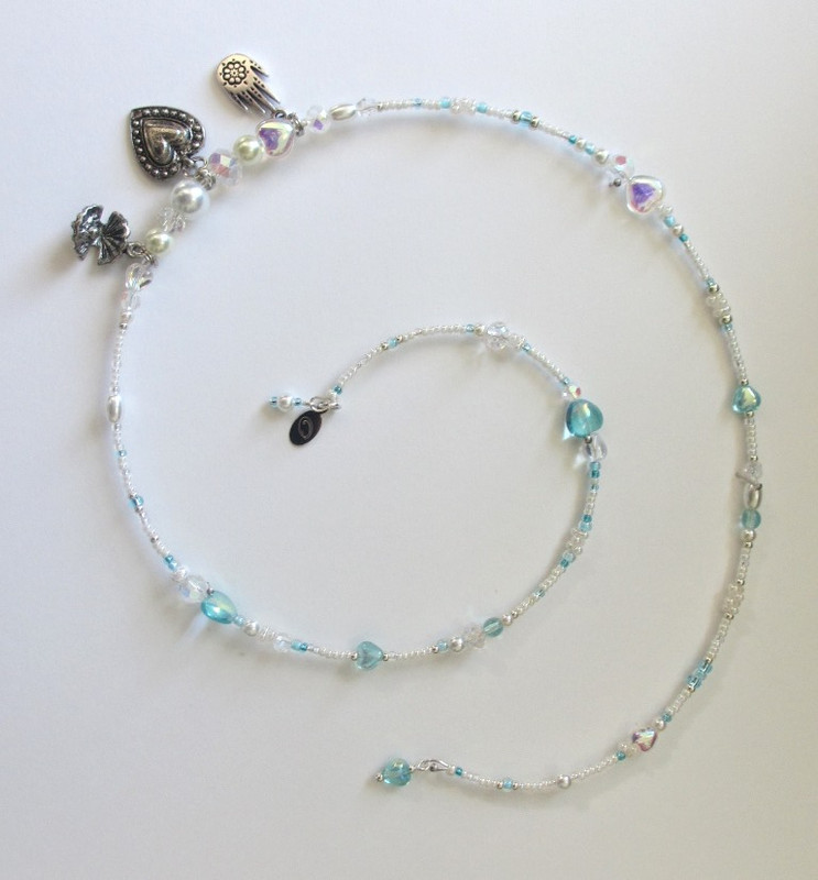 Glass pearls, crystals and hearts enhance The Pearlescent Love Bracelet  inspired by Bizet's The Pearl Fishers.