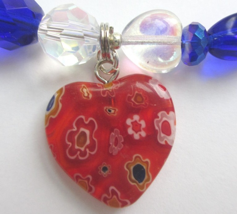 Millefiore heart beads represent the setting of Venice.