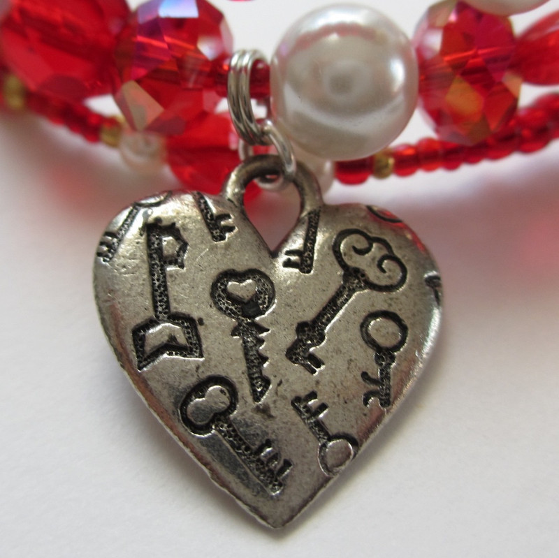The heart with keys charm indicates Figaro's role as a matchmaker