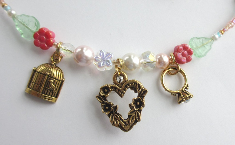 "Charms symbolize different aspects of the opera Gianni Schicchi and the famous aria ""O mio babbino caro""."