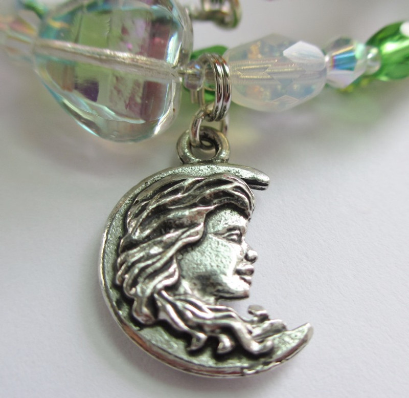 "The  woman's face in a crescent moon symbolizes the famous aria ""Casta Diva""."