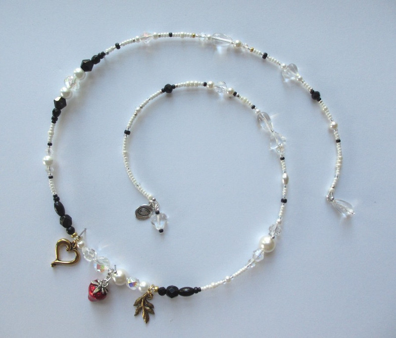 Creamy pearls indicate Desdemona's innocence and the bridal gown she will be buried in; Black beads are her dark fate.