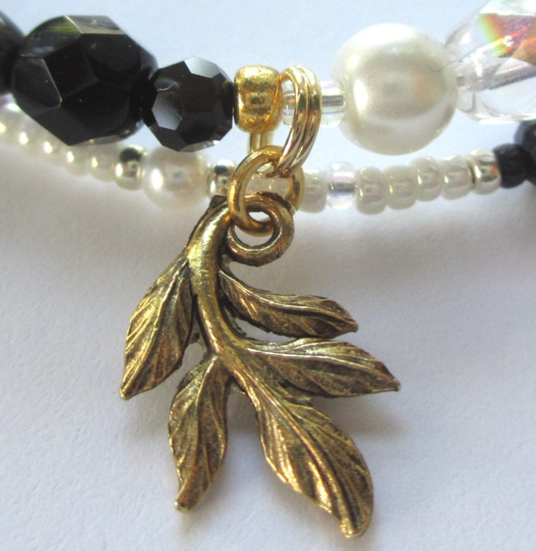 """The leaf charm symbolizes the famous, mournful """"Willow Song""""."""