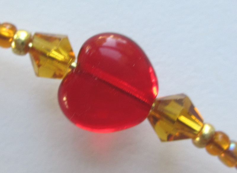 Red glass hearts symbolize the sensual love of Venus.