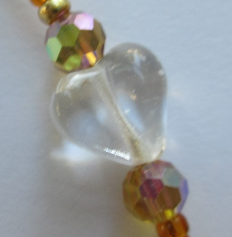 Clear glass hearts represent Elizabeth's pure love.