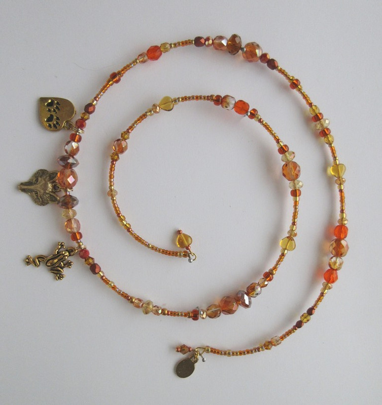 Amber, orange and coppery glass beads evoke the beauty of the Vixen's fur on the Cunning Little Vixen Bracelet