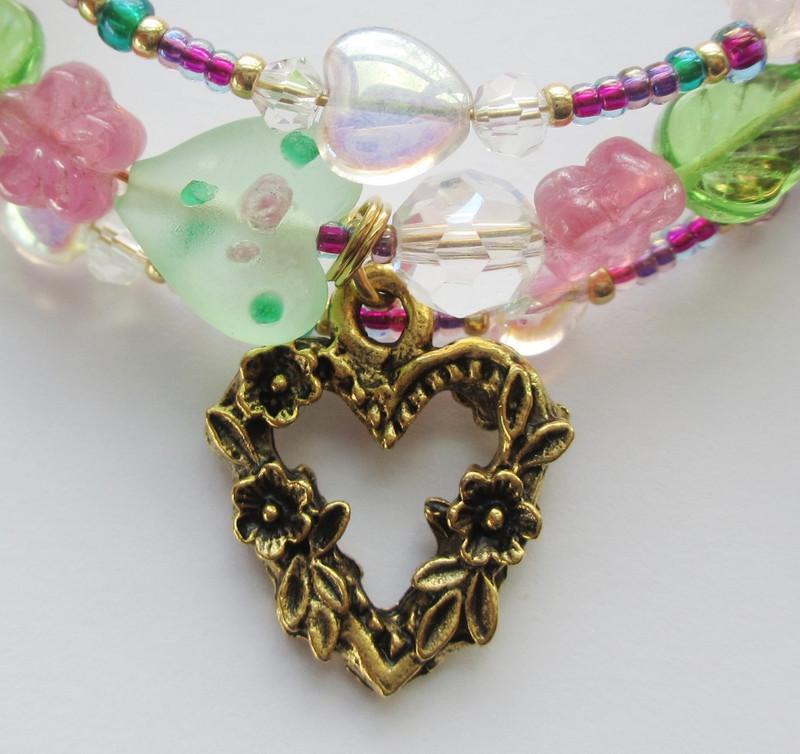 A heart charm represents Norina and Ernesto's garden love rendezvous.