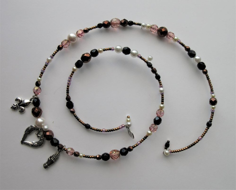 The moving opera Dialogues of the Carmelites and the true story of the Martyrs of Compiègne, inspired this bracelet.