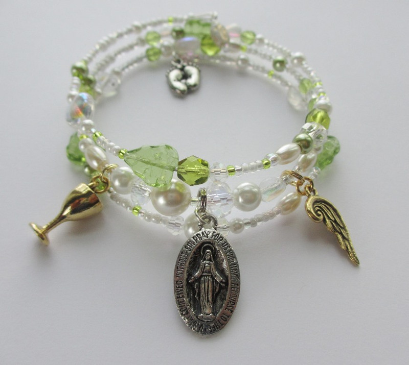Beads and charms represent the story of Suor Angelica, Puccini's one act opera.