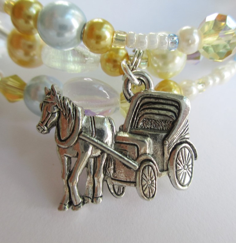 "A carriage charm symbolizes the ""surrey with the fringe""."