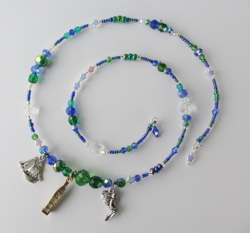 Deep blue and green beads with delicate glass stars evoke the night time flight to lush Neverland.