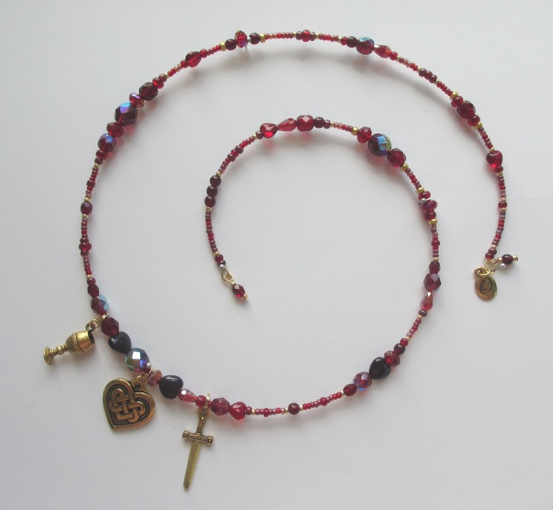 Beads and charms represent Act 1 of the Wagner opera Tristan und Isolde.