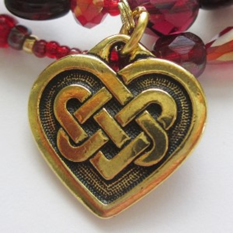 The Celtic knot heart symbolizes the winding together of the lives of Tristan and Isolde upon drinking the love potion.