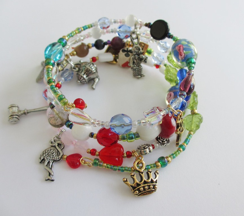 Beads and charms tell Lewis Carroll's famous tale- Alice in Wonderland.