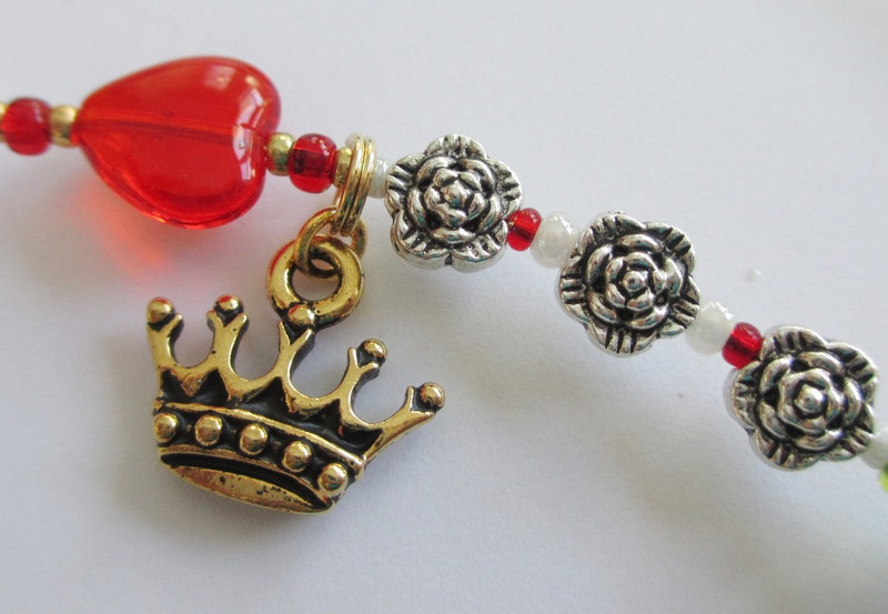Queen of Hearts (red heart bead and crown) and roses being painted from white to red.