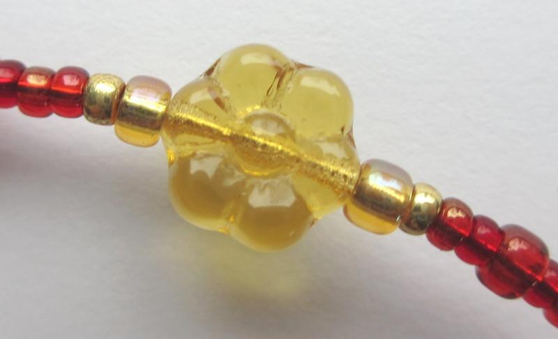 Golden glass flowers symbolize Gilda.