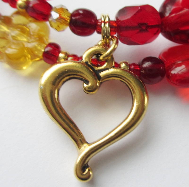 A heart charm representsis Gilda's love for her father, Rigoletto.