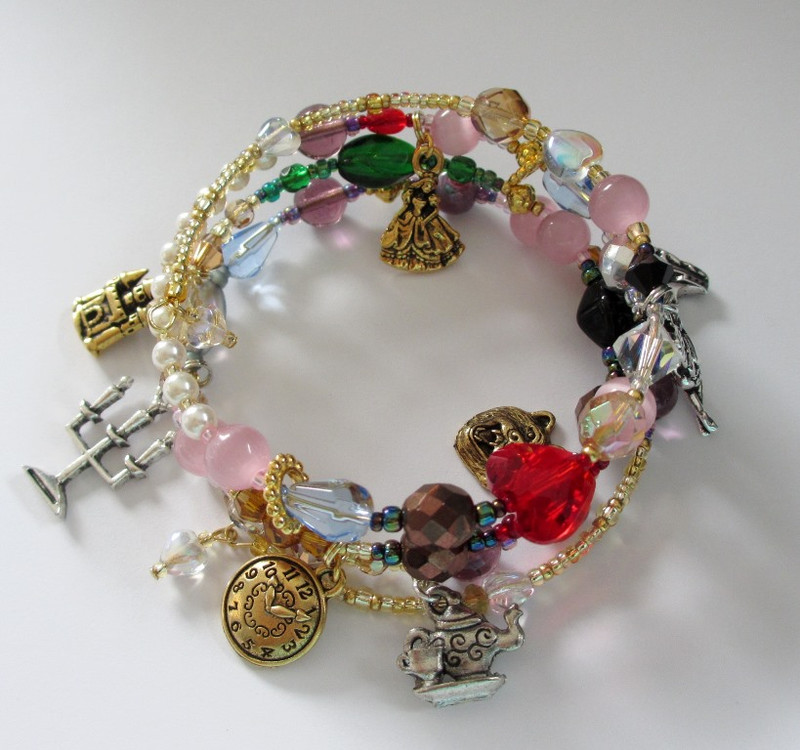 Beads and charms tell the narrative of the beloved fairy tale: Beauty and the Beast.