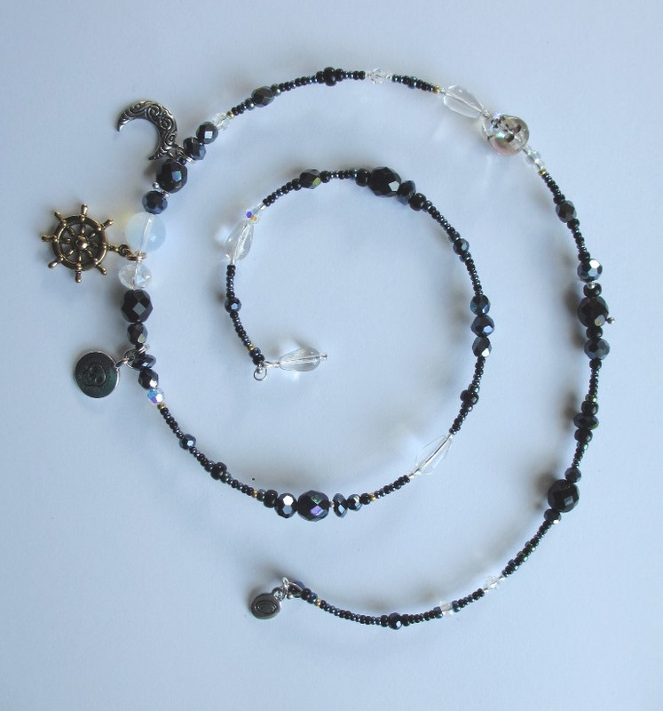 I chose black luster and aurora borealis beads to evoke the mystery of fate and fortune.
