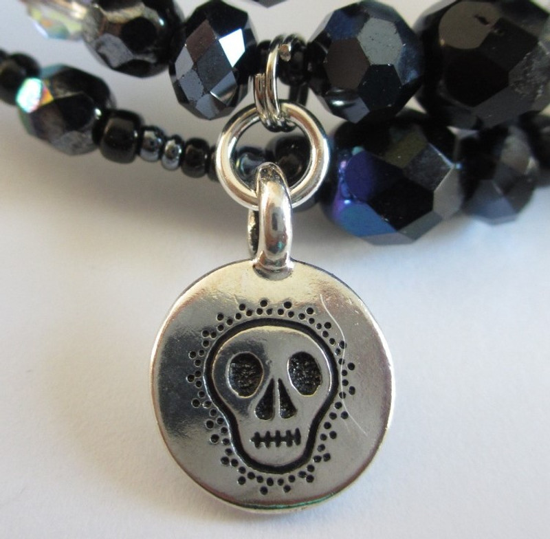 "A skull charm represents death, the ""fate that strikes down even the strong""."