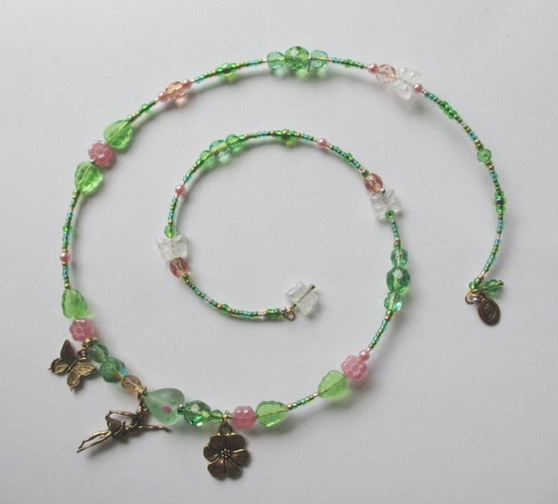 Glass flowers, leaves and butterflies evoke the lush garden in which the Flower Maidens exist.