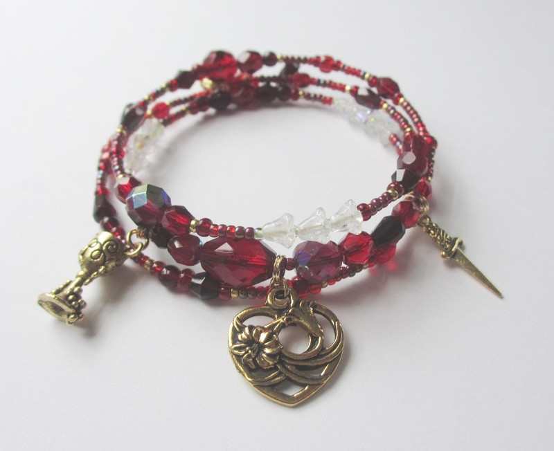 Blood red glass beads symbolize Turiddu's death while trumpet flower beads further evoke the ironic setting of Easter Sunday.