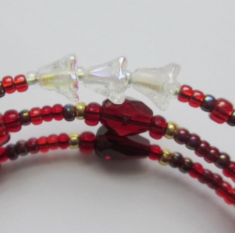 Iridescent trumpet flower beads evoke the ironic setting of Easter Sunday.