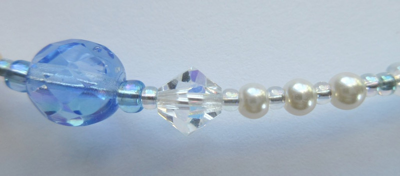 The mermaid's grandmother (blue bead) explains that humans have a short life with an eternal soul (clear crystal); mermaids live 300 years (three small glass pearls) but have no soul.