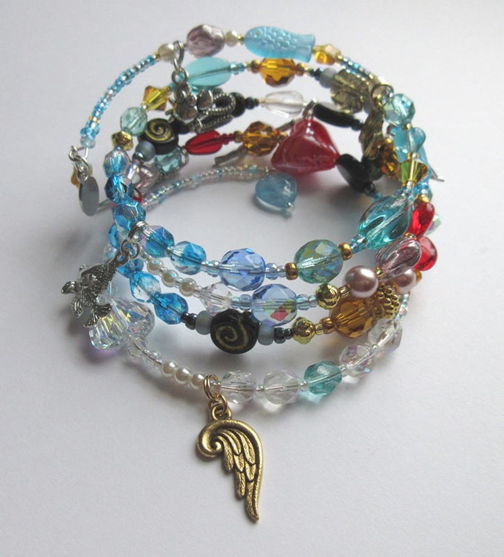 Beads and charms symbolize characters and events in the tale of the Little Mermaid.